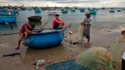 Boys working in fishing village, Mui Ne